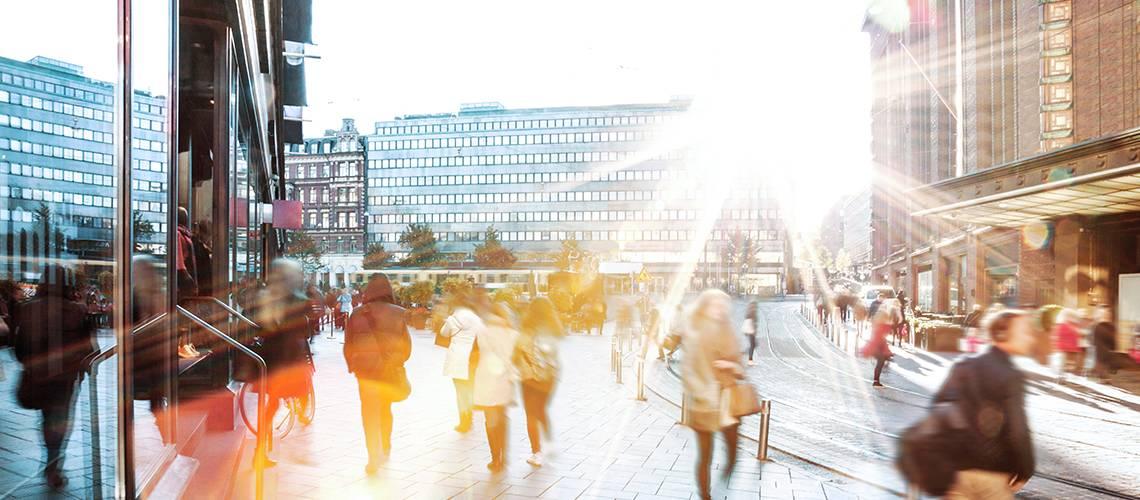 blurred people on sidewalk