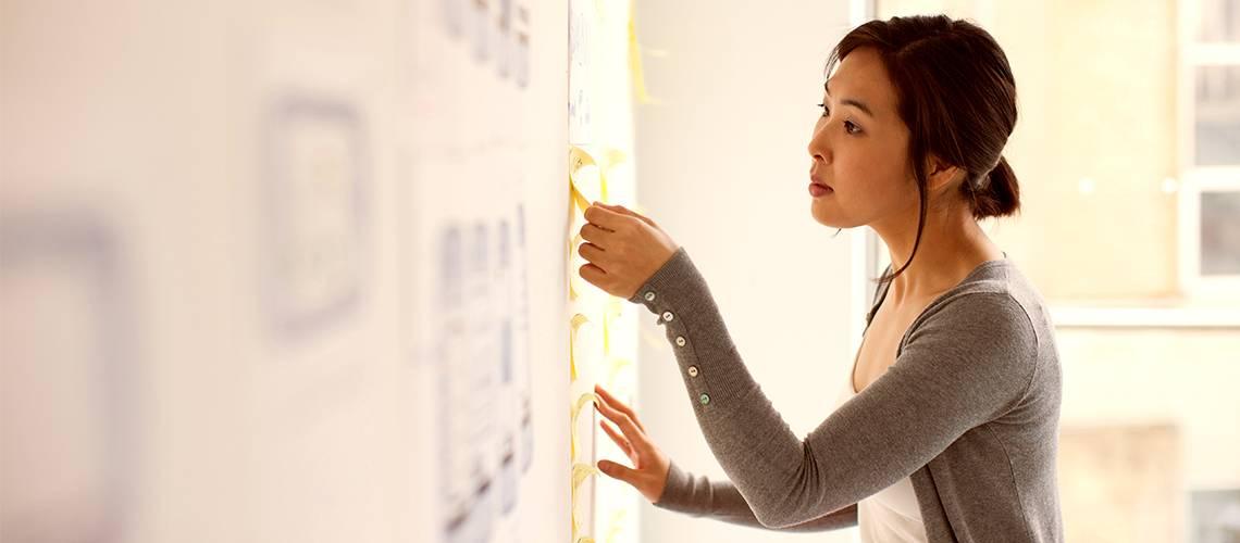 Woman scrutinising board