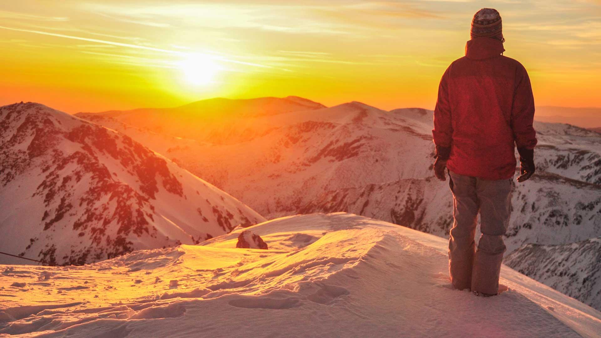 Climber facing sunset
