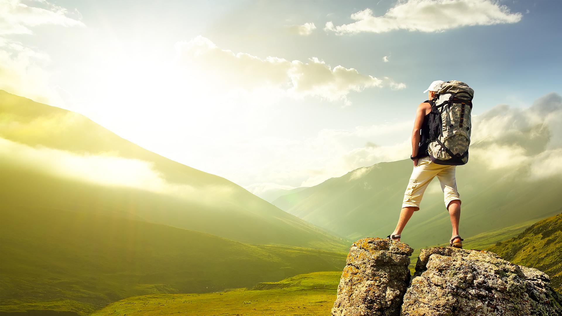 climber surveying mountain