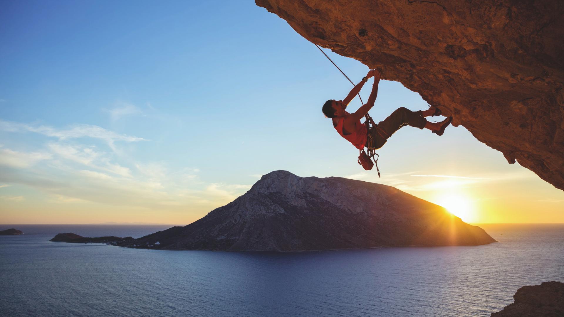 Climber under rock