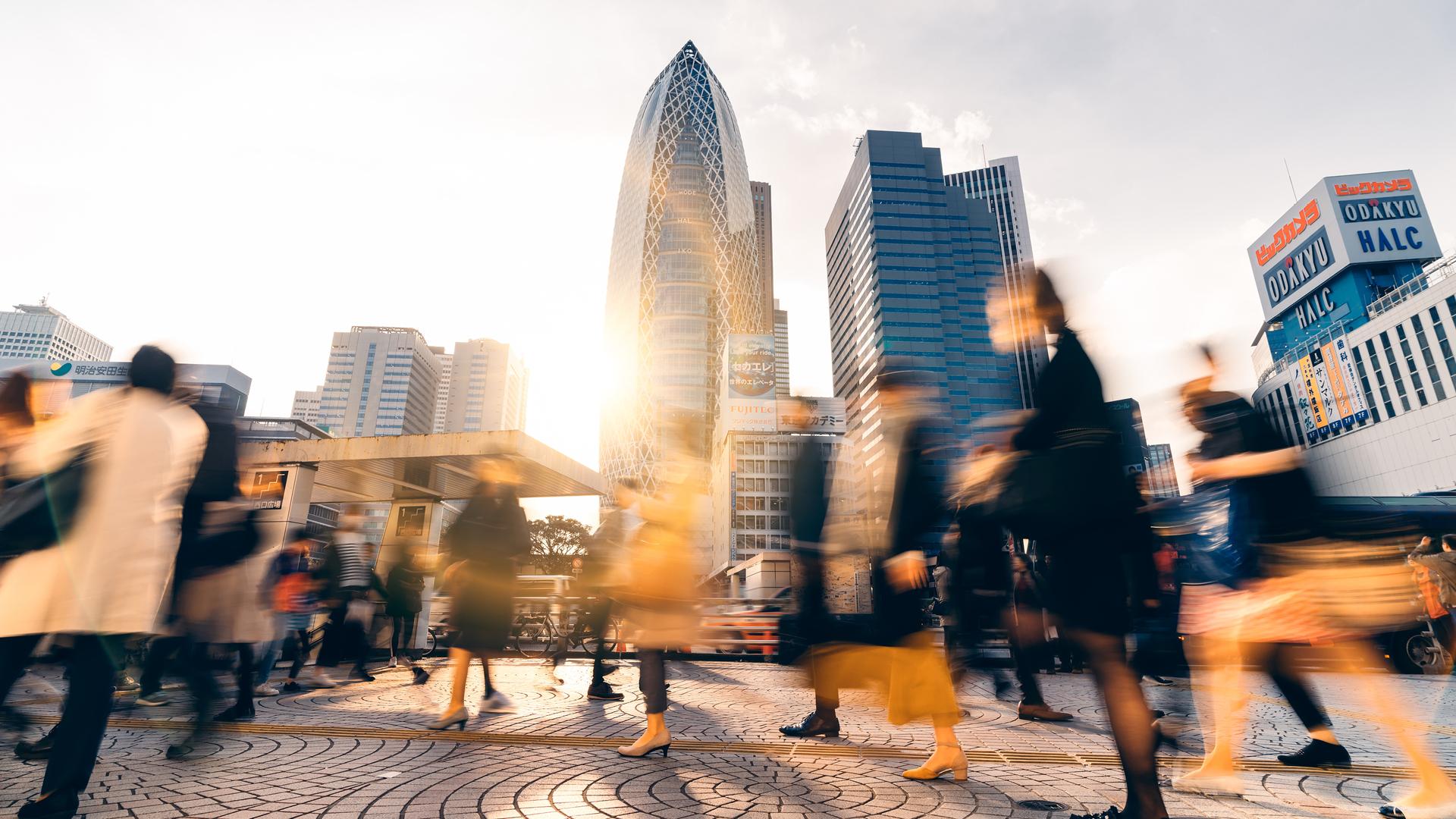 People walking through city