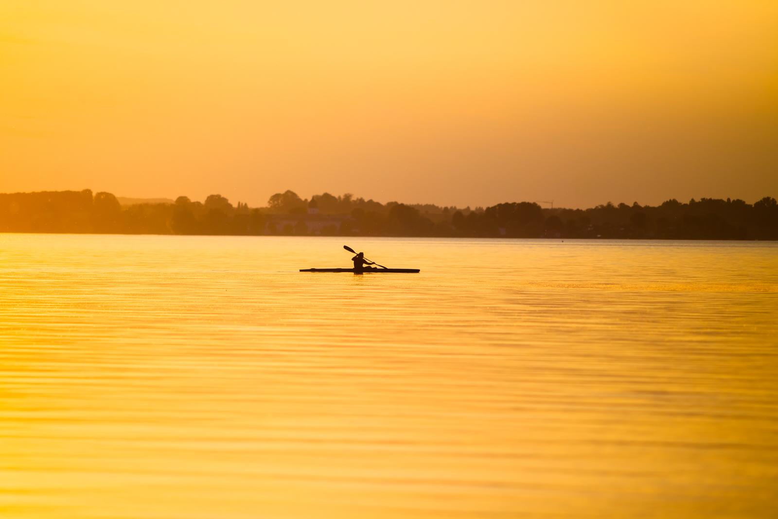 kayak paddler lake